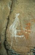 Aboriginal art on rock - stock photo