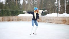 Happy teenager girl graceful skates and spins at ice rink at winter Stock Footage