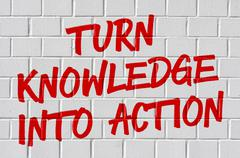 Graffiti on a brick wall - Turn knowledge into action - stock photo
