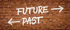 Future or Past written on a brick wall - stock photo