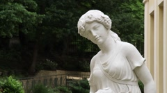 Young lady white statue sculpture in the garden Stock Footage