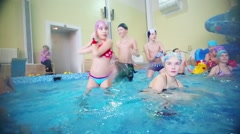 Children play in indoor pool in Holiday House and Hotel Stock Footage