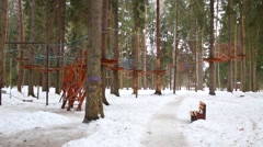 Monkey park with sophisticated rope path in winter forest - stock footage
