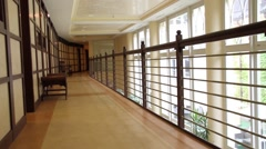 Upper level wooden corridor with railing Stock Footage