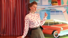 Woman dance near stage and peeks behind curtain in retro restaurant Stock Footage