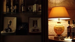 Expensive drinks shelve besides a lamp Stock Footage