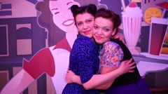 Two women embrace and push each other at  Retro Beauty Day Stock Footage