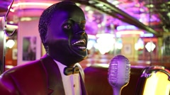 African singer sculpture of Beverly Hills Diner Stock Footage
