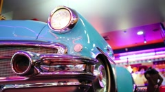 Close up of two retro cars headlights in restaurant - stock footage