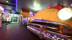 Shiny retro cars with tables in Beverly Hills Diner Stock Footage