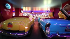Old cars in Beverly Hills Diner - network of American restaurants Stock Footage