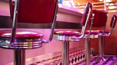 Close up view of red seats near bar counter in restaurant - stock footage