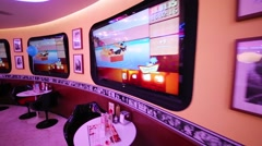Displays with american cartoons in Beverly Hills Diner Stock Footage