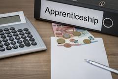 Apprenticeship written on a binder Stock Photos