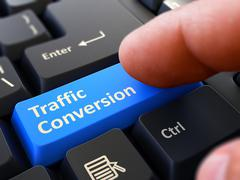 Traffic Conversion - Written on Blue Keyboard Key Stock Illustration
