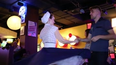Young couple dance at Retro Beauty Day in Beverly Hills Diner Stock Footage