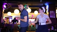 Couple dance at Retro Beauty Day in Beverly Hills Diner Stock Footage
