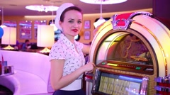 Woman near jukebox at Retro Beauty Day in Beverly Hills Diner Stock Footage