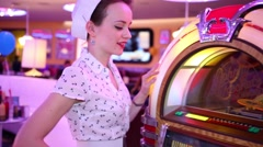 Woman pushes button of Jukebox at Retro Beauty Day Stock Footage