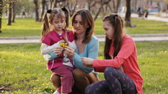 mother and daughter find flowers in the bouquet - stock footage