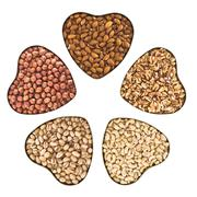 Nut mix in a heart shaped boxes Stock Photos