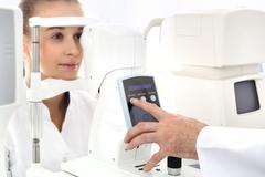 An eye exam, a visit to the eye doctor . - stock photo