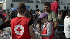 EDITORIAL: Сharitable organization Red Cross handed out Syrian refugees food Stock Footage