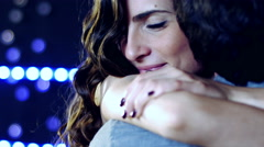 Woman in love hugging strong boyfriend in street of city 4K - stock footage