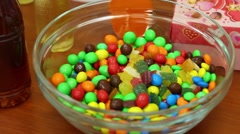 M & Ms sweets and bottles of drinks on table. Stock Footage