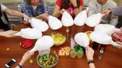 Hands of ten young people hides table by masks and pick it up Stock Footage