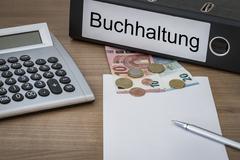 Buchhaltung written on a binder - stock photo