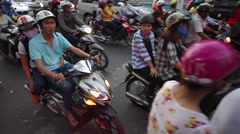Unidentified people drive by motorcycles in district one Stock Footage