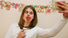 Pretty girl makes selfie with cardboard lips. Stock Footage