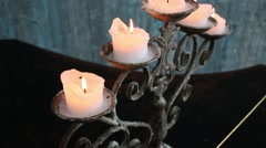 Five burning candles on beautiful wrought-iron candlestick Stock Footage