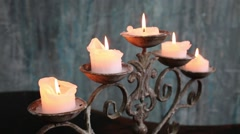 Close up view of five burning candles on old wrought-iron candlestick Stock Footage