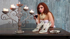 Pretty woman in white dress poses with wine near black grand piano Stock Footage