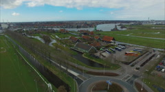 Netherlands Windmill Village, Flyover Roundabout and Parked Buses Stock Footage