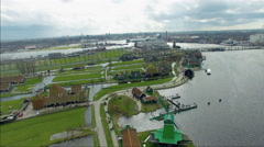 Netherlands Windmill Village, Flyover Viewing Windmill, Land & Buildings Stock Footage
