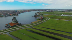 Netherlands Windmill Village, Flyover Land Viewing Windmill Going Towards Water Stock Footage
