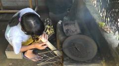 Woman is roasting coffee beans,Bali Stock Footage