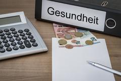 Gesundheit written on a binder - stock photo