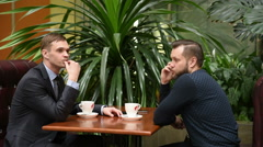 Businessman waiting. evinces impatience. knocking fingers. colleague talking on Stock Footage