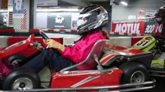 Girl and boy in karts (models with releases). RRT Kart - modern playground Stock Footage