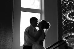Silhouette couple kissing Stock Photos