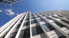 Windows od business center and blue sky at sunny day Stock Footage