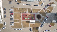 Top view of children playground and car parking near buildings Stock Footage