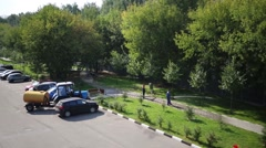 Workers watering lawns of hose in Moscow at summer day Stock Footage