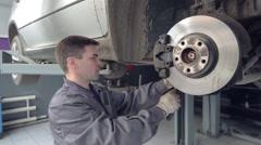 Man Changing Shoe of Brake - stock footage