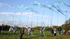 People and flags on festival of kites Colourful sky in Kolomenskoye Stock Footage