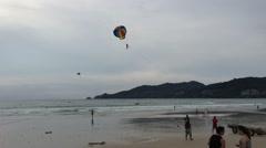People paragliding at Patong beach, Phuket, Thailand - stock footage